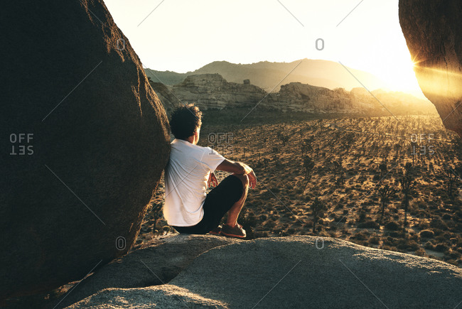 Man and sunrise in Joshua Tree Ca.