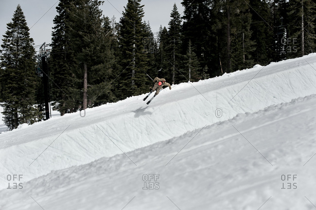 skier jumping into half pipe in lake tahoe, ca