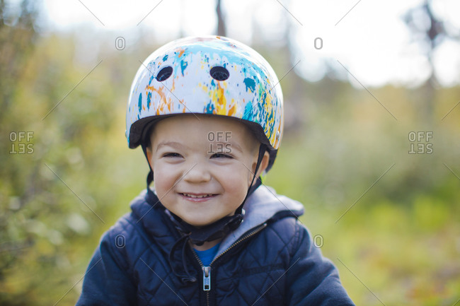 Portrait of young boy with bike helmet on.