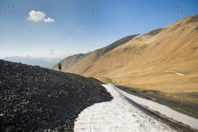Hiker on rocky ridge, British Columbia, Canada