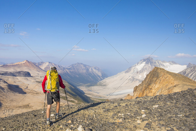 backpacker approaches view of Athelney Pass, British Columbia, Canada