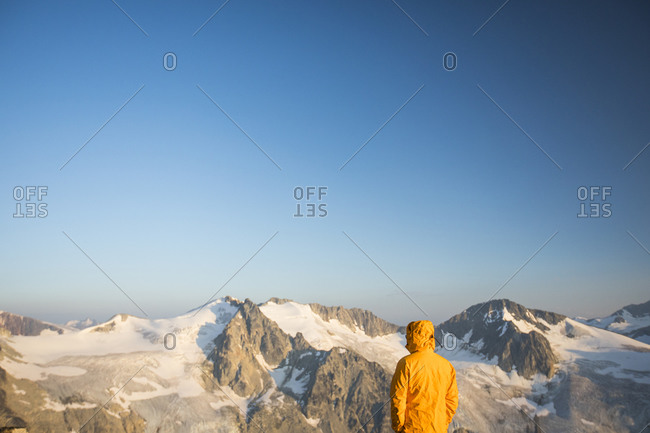 Hiker looking at view of glaciated mountains in Canada.