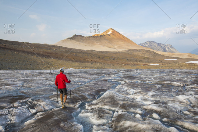 hiker crosses glacier towards Ochre Mountain.