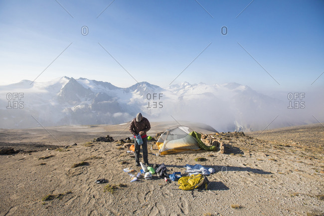 climber prepping gear at basecamp.