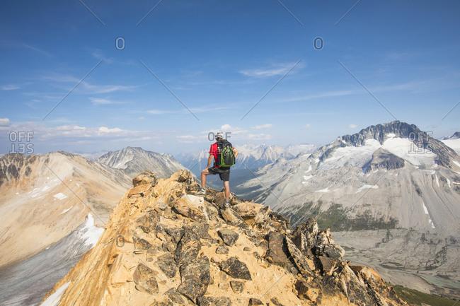 Hiker standing on summit of Ochre Mountain, Canada.