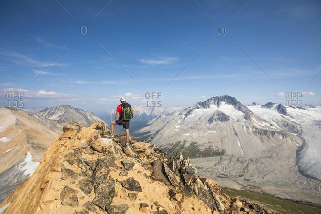 Backpacker standing on mountain summit.