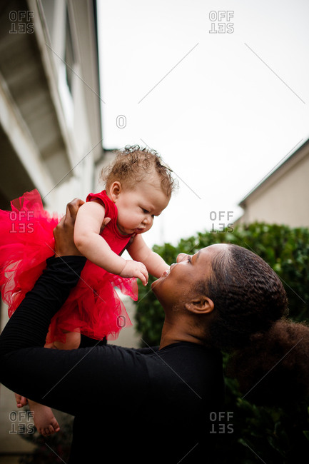 African American Step Sister Holding  Biracial Baby Sister