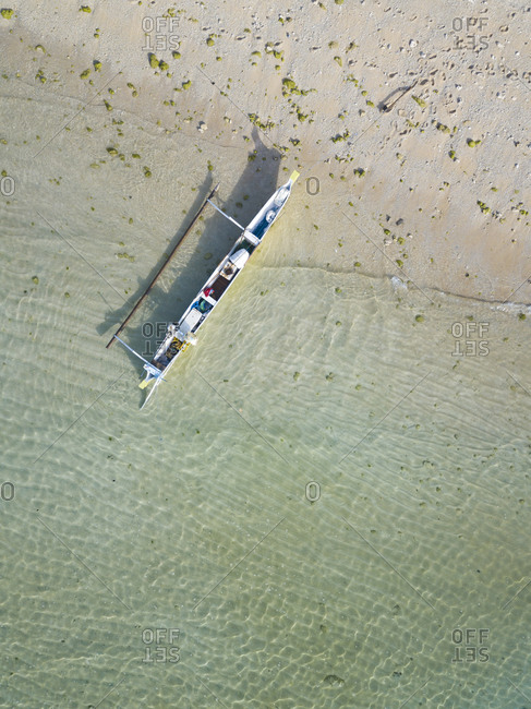 Aerial view of beach and  banca boat
