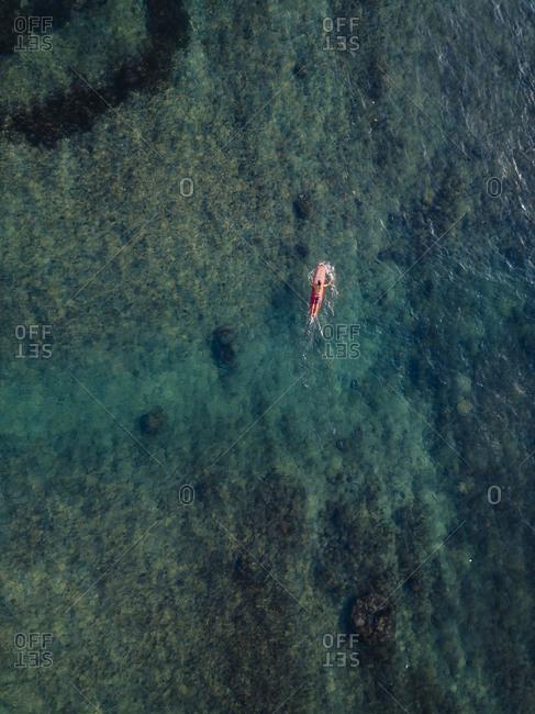 Aerial view of surfer in the ocean