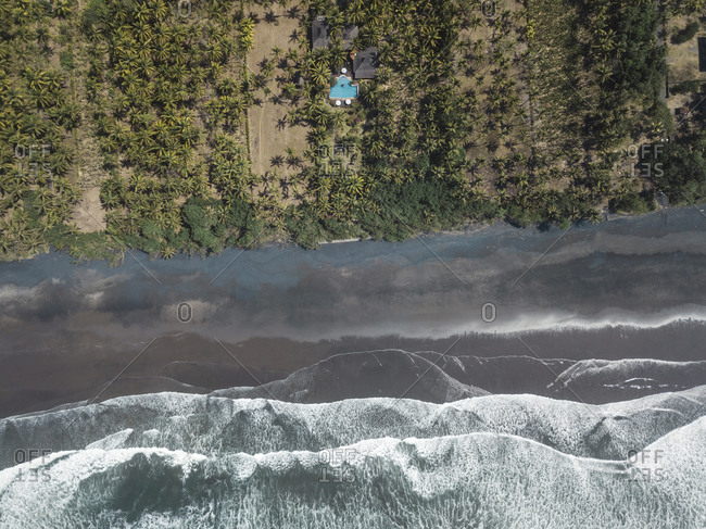 Aerial view of house with pool near the beach