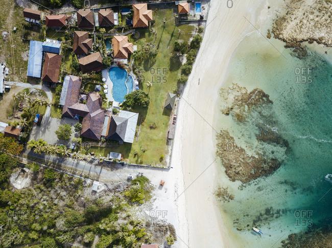 Aerial view of tropical resort at ocean coastline