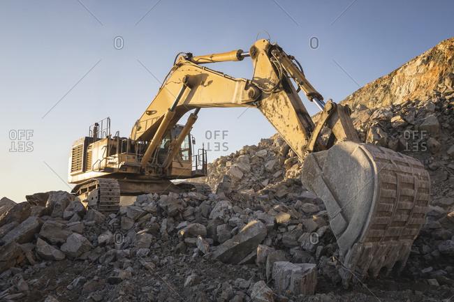 Mining machinery working over rocks