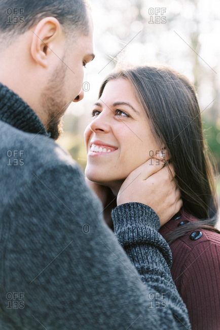 Freshly engaged couple posing for their engagement photos.