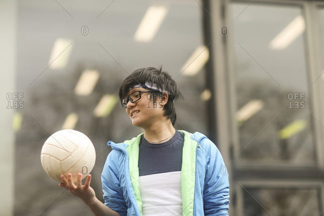 young man outside with ball
