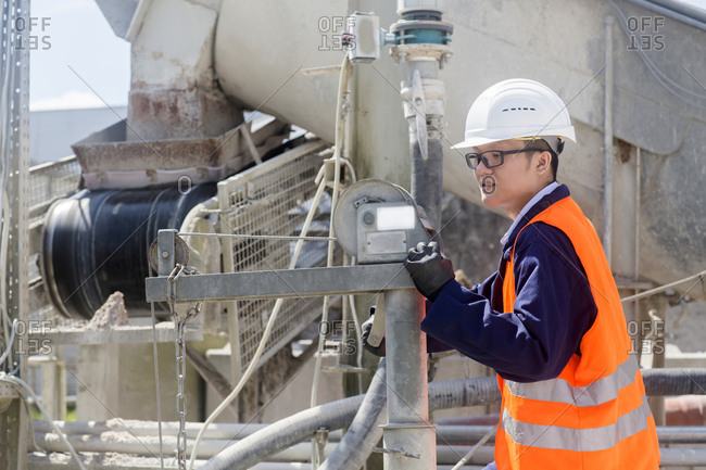 concrete worker checking machine in a concrete factory