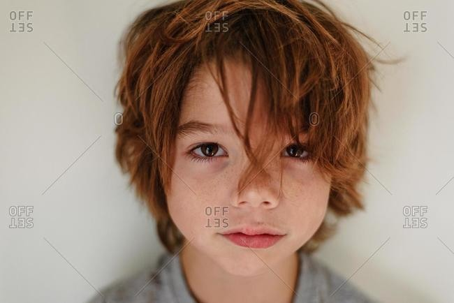 Portrait of a boy with messy hair