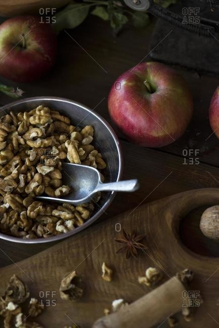 Bowl of walnuts and apples