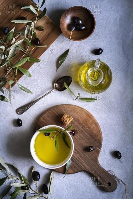 Fresh olives and olive oil arrangement