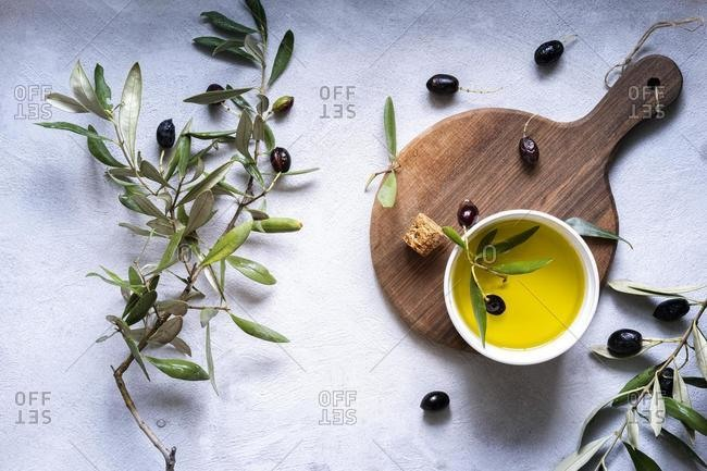 Fresh olives and olive oil arrangement