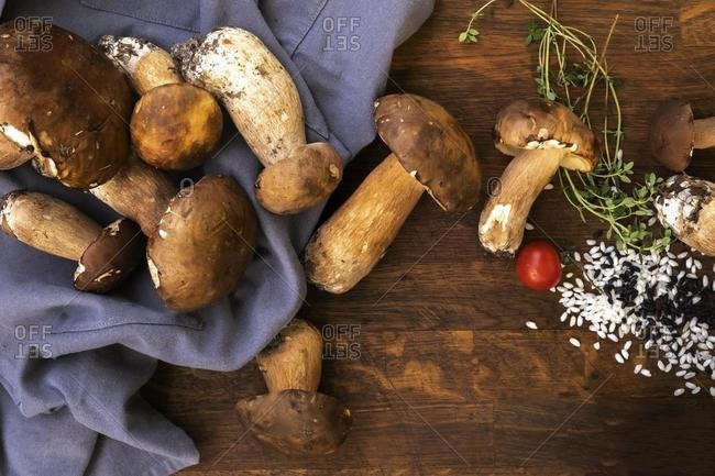 Rice, wild mushrooms and thyme ingredients for a risotto