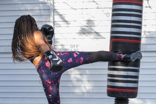 Cuban Athlete woman doing kick boxing training