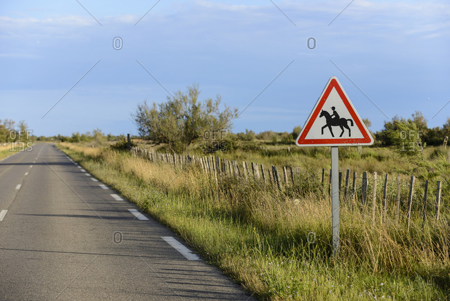 Horse crossing sign in the Camargue countryside, Bouches du Rhone, France