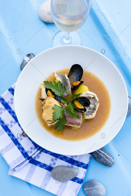 Overhead view of bouillabaisse fish stew served in French restaurant