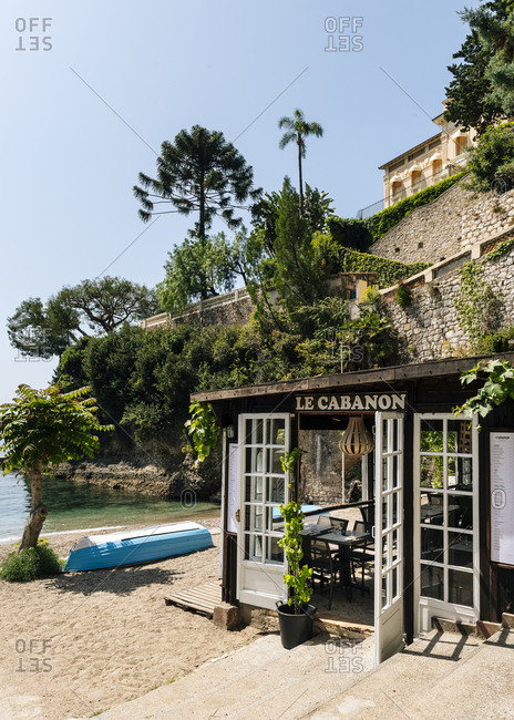 Roquebrune-Cap-Martin, France - May 25, 2018: Le Cabanon beach restaurant at Plage du Buse in Roquebrune Cap Martin, Alpes-Maritimes France