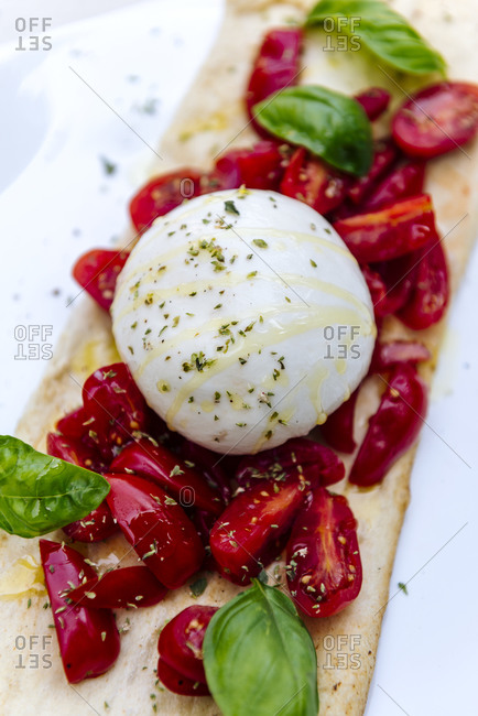 Burrata e San Marzano cherry tomato at beach restaurant  in Roquebrune Cap Martin, Alpes-Maritimes France