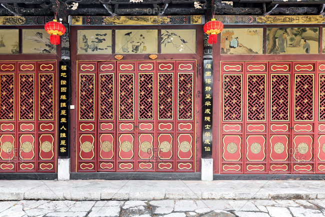 Jianshui, China - March 7, 2019: March 7, 2019: Chinese wooden red and golden door