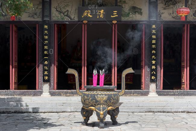 Jianshui, China - March 7, 2019: Burning incense sticks in a Chinese Temple in Jianshui, China