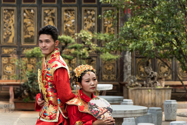 Jianshui, China - March 7, 2019: March 7, 2019: A Chinese couple dressed with traditional old clothes in front of an historic house in Jianshui, China