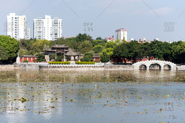 Jianshui, China - March 8, 2019: March 8, 2019: Garden with lotus in the pond in the Confucian Temple (Wenmiao), Jianshui, Yunnan, China. One of the biggest and oldest Confucian temples. National heritage