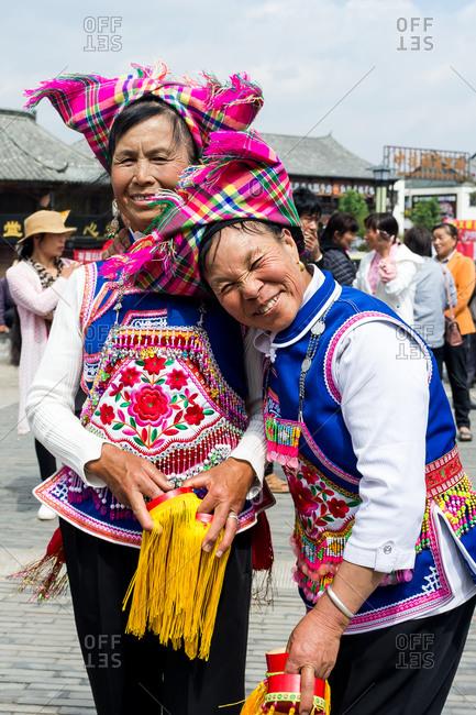 Jianshui, China - March 8, 2019: March 8, 2019: Senior Chinese women dancing with traditional dress in front of the famous Chaoyang Gate in Jianshui, Yunnan, China