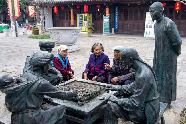 Jianshui, China - March 8, 2019: March 8, 2019: old People gathering and enjoying their leisure time in a square, Jianshui, Yunnan, China