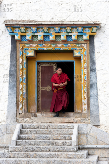 Shangri-la, China - March 20, 2019: March, 20. 2019: Tibetan monk in Songzanlin monastery, also known as Ganden Sumtseling Gompa. Zhongdian, Yunnan, China