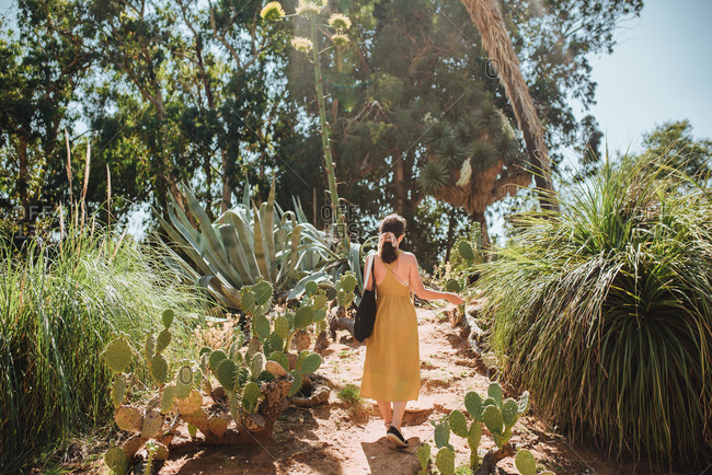 Woman walking through botanical garden in Lokrum, Croatia