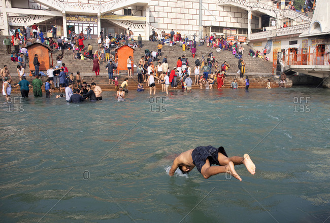 Haridwar, India - January 9, 2020: Man diving into the Holy Ganges River