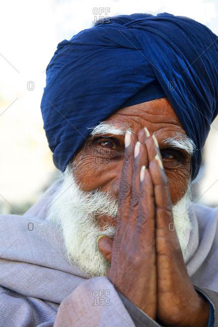 Amritsar, India - January 6, 2020: Man praying at The Golden Temple