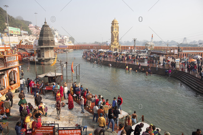Haridwar, India - January 9, 2020: Hindus bathing themselves in Ganges Holy River for blessings of Hindu spirits