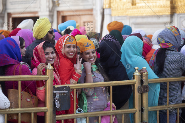 Amritsar, India - January 6, 2020: Sikh worshippers in line at the Golden Temple entrance