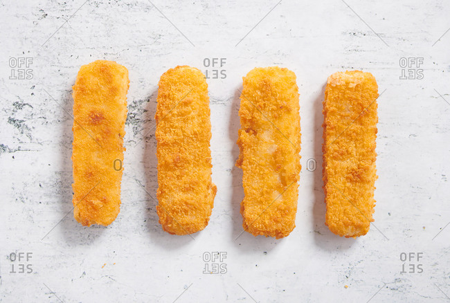 Fish sticks and French fries on neutral background