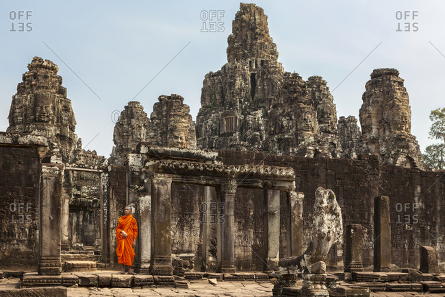 Novice monk in ruined temple