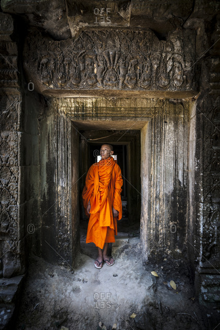 Novice monk in ruined building
