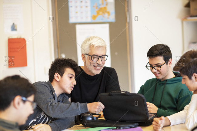 Teacher in classroom talking with students