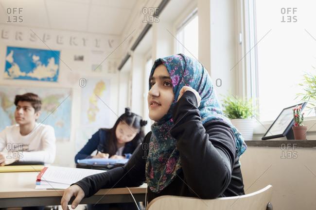 Teenage girl in classroom - Offset