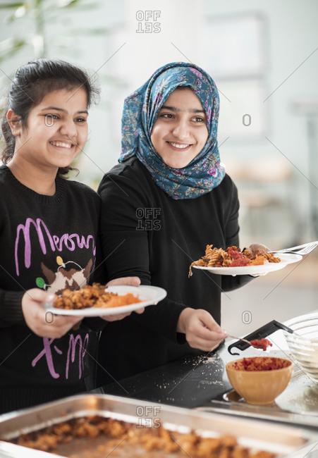 Smiling girls in school canteen