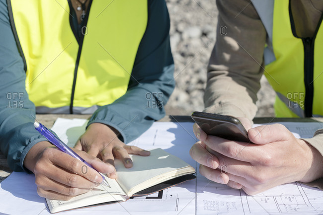 Making notes at construction site