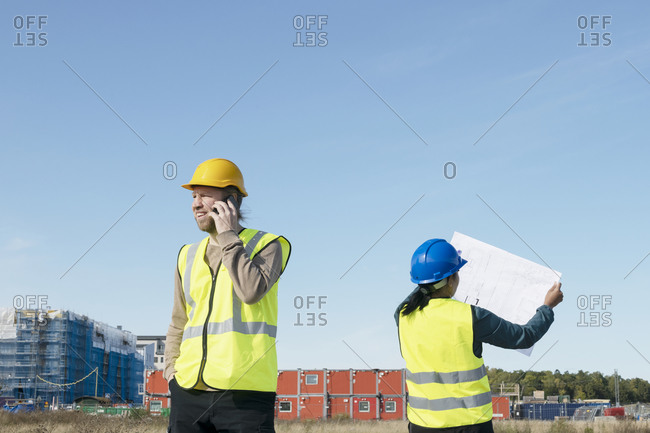 People on construction site - Offset