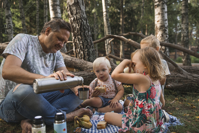 Father with children having picnic